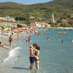 Soul meets soul on Levanto's beach (Bn) Tags: travel family blue boy sea summer vacation italy baby holiday hot love beach water colors girl sunshine swimming magazine children fun coast seaside italian sand couple rocks mediterranean italia day afternoon locals play liguria families joy group young relaxing traditions down tourist tourists romance line resort busy delight parasol grandparents soul towels romantic bathing activity lying popular quaint amore meet sunbathing pleasure lamour adriatic sunbather crowded cooling levanto booking jammed sunbeds overrun