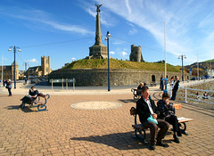 Aberystwyth Castle and War Memorial (Minoltakid) Tags: street old uk people building castle heritage wales clouds buildings bench town seaside westwales oldbuildings streetscene historic seawall aberystwyth lamppost promenade gb seafront townscape warmemorial ceredigion oldbuilding sunnyday welshcoast welshheritage aberystwythcastle welshseaside aberystwythwarmemorial minoltakid theminoltakid