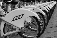 spin it! (piazza duomo - milan, italy) (bloodybee) Tags: street city urban bw italy milan ecology bike bicycle wheel square europe traffic milano transport perspective diagonal pollution duomo piazzaduomo