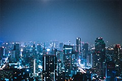 (toby.harvard) Tags: camera city longexposure blue rooftop vertical skyline night analog skyscraper 35mm thailand photography 50mm photo asia flickr downtown cityscape photographer nocturnal rooftops pentax kodak iso400 bangkok grain spiderman picture 200iso photograph 35mmfilm 400 pentaxk1000 moonlight analogue redlight nuit analogphotography shimmer 400iso observationdeck celluloid filmphotography 50mmlens analoguephotography lebua tumblr thehangover2 tobyharvard