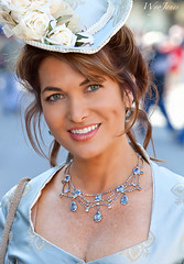 Victorian Beauty with  Dimples (wyojones) Tags: texas galveston dickensonthestrand victorianholiday festival christmas strand holiday hat brunette blueeyes smile teeth eyes lips curls blue victorian beauty girl woman pretty beautiful lovely necklace freckles earrings gorgeous roses wyojones melissa wilson melissawilson