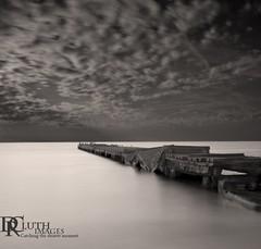 Broken Pier (Dennis Cluth) Tags: art beach nikon long exposure florida monotone coastal bradenton d800 coasta bradentonbeach