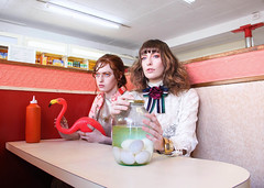 IRREGULAR SKELETONS (BRYAN M. FERGUSON) Tags: bryanmferguson diner girls flamingo flamingos glasses pickles pickledeggs eggs chippy chipshop booth fashion editorial neon light colour colours color colors weird strange jar green pink red orange hair glasgow scotland scottish irregularskeletons weirdos dorks geeks nerds kooky