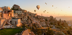 It's nice to be here! (acipinarli) Tags: sky sunrise mountains travel vacation flight colors fly panorama valley balloons anatolia cappadocia turkey uhisar hotairballoons fairychimneys tallespoint light