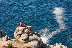 Teenagers enjoying the view in Finisterre (basair) Tags: red galicia sea atlantic spain coastline landscape scenics nature atlanticocean wave water sky seascape outdoors europe watersedge tide summer vacations traveldestinations blue environment rock sunlight stone turquoise watersurface rockycoastline ocean cliff peninsula coast electriclight waterfront danger builtstructure colorimage day finisterre famousplace tower santiagodecompostela caminodesantiago pilgrimage iberianpeninsula cabodefinisterre costadamorte acoruna finisterrae capefinisterre