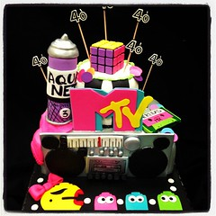#80's cake #legwarmers #aquanet #pacman #mrspacman #mtv #i80's #tape #boombox #rubixcube #checkeredd (Royalty_Cakes) Tags: birthday pink blue blackandwhite white man green art cakes colors yellow square 40th mix aqua neon bright sweet lavender stereo polkadots tape 80s bow mtv cube boombox ww mrs past checkered legwarmers blast speakers royalty pac chino aquanet fondant rubix 2tier iphoneography