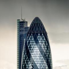 The Gherkin and The Heron (cybertect) Tags: building london architecture skyscraper normanfoster 30stmaryaxe se1 cityoflondon kpf kohnpedersenfox londonse1 fosterpartners kenshuttleworth herontower canonfd135mmf25sc panasonicg2