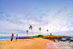 People on Beach enjoying Sunset (Andreas Krappweis - thanks for 1,9 million views!) Tags: ocean travel sunset sea people beach water rock palms evening sand rocks asia waves relaxing srilanka ceylon coconuttrees leisuretime enjpying