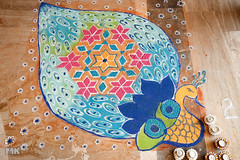 Diwali Rangoli 2 (Muslim Kapasi) Tags: blue india art beautiful festival circle flickr colours floor sale drawing circles culture peacock celebration round bombay getty colourful draw tradition diwali mumbai sell hindu celebrate kolam rangoli gulal floordrawing