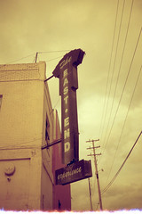 East End (TheAgeOfAnalog) Tags: film oklahoma sign downtown kodak rangefinder olympus east wires 25 200 end tulsa xa 35 f28 compact clamshell redscale