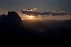 Sunset at Half Dome - Yosemite (hjl) Tags: california blue light sunset orange mountains film nature silhouette canon 50mm day cloudy ae1 scenic sierra yosemite lensflare halfdome rays photocd pcd pcdtojpeg