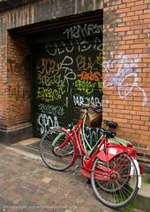 two lonely bikes (The Last Hegemon) Tags: summer building bike bicycle wall copenhagen denmark graffiti europe pentax scandinavia 18135 pentaxkr