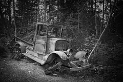 can't get my motor to start... (freakingrabbit) Tags: rust vintage old oldtimer wreck car nlack abandoned black white alaska usa popular tags woods derelict