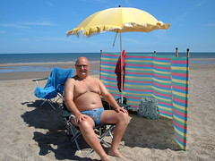 Relaxing after a paddle in the North Sea (pj's memories) Tags: huttoft kiniki tanthru trunks briefs beach speedos seaside slip windbreak umbrella northsea