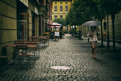 Piotrkowska street. (Tomasz Aulich) Tags: backyard street architecture building windows door umbrella wpman onthestreet vintage oldschool rain table chair glass tree plant flower green outdoor dress travel nikon poland lodz piotrkowska piotrkowskastreet city people girl summer