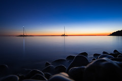 blue is the warmest hour (almostsummersky) Tags: horizon surface sunset tennisonbay reflection boats evening sailboat dusk longexposure bluehour water twilight rocks bay peninsulastatepark waves ripples lake lakemichigan fishcreek wisconsin unitedstates us
