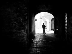 urban cowboy (Sandy...J) Tags: olympus oldtown monochrom fotografie mono noir sonnenlicht cobblestones atmosphere atmosphre alone allein altstadt blackwhite bw black bavarian bayern city deutschland darkness dark dunkelheit durchgang einfarbig fahrrad photography passage light licht urban man mann mauer white wall wand street streetphotography sw schwarzweis strasenfotografie stadt silhouette shadow sunlight strase germany gegenlicht backlight