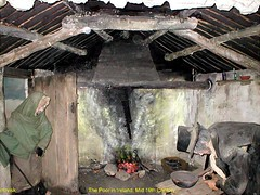 Ireland.- The Poor in Ireland, early 19th Century. (mrvisk) Tags: old irish history surviving hardship rags nothing humble woman man green shawl shack fireplace mature husband wife amen home sweet proud people pride heat food fire 1820s pic wooden beams cottage groupshot hunger mrvisk