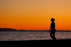 end of day (Karol Franks) Tags: carpinteria beach ca socal ocean sunset walking girl endofday november 2012 karolfranks orange sky karolfranksgmailcom ©2014 ©karolfranks okarolyahoocom