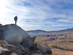 Daniel on top of the world (QsySue) Tags: family mountains digital lumix utah rocks hiking daniel hike panasonic trail santaclara pointandshoot digitalcamera petroglyph petroglyphs digitalpointandshoot anasazitrail panasoniclumixdmczs8 ancientrockdrawing ancientrockwriting