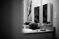 Me, Myself, and I (Michael Mendonca) Tags: portrait bw white black film college wall marilyn contrast self poster bathroom mirror michael nikon paint university apartment counter sink cabinet grain inspired monroe medicine relfection ucf mendonca d700