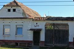 Rte DJ141 (anyone recognize the symbols over the door?) - Pelior, Jud. Sibiu, Romania (Wayne W G) Tags: door houses house europe doors village villages romania hex easterneurope saxon sibiu pelisor pelior geo:country=romania dj141