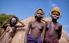 Mursi girls. Mago national park, Ethiopia (NeSlaB .) Tags: poverty africa portrait woman black girl beauty look hat youth canon painting photo costume eyes women body traditional country young earring culture photojournalism folklore tribal clothes ornaments bracelet earrings tradition ethiopia tribe ethnic mago scar mursi scarification developingcountries reportage coiffure afrique ethnography ethnology jinka etiopia spiritualism debub neophronpercnopterus ethnies snnpr  murzu southernnationsnationalitiesandpeoplesregion neslab