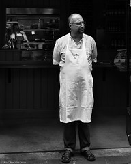 The man behind the counter. (Neil. Moralee) Tags: street blackandwhite bw food white man black cooking monochrome st bristol cafe nikon market cook apron nicholas eat chef hal d5000 neilmoralee