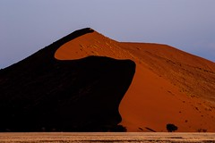 Red Dune at sunset (Kuba Abramowicz) Tags: world africa park old travel sunset red sun mountain mountains color colour nature colors lines yellow dark landscape outdoors dawn high sand nikon scenery colours view outdoor dunes south sandy dune curves scenic landmark line southern national vista afrika curve namibia namib curvey hight souht d80 namibnaukluft aryka