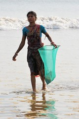 Hungry Shells....... (pallab seth) Tags: sea portrait india industry beach women waves basket candid poor feeder poultry exploitation lowtide collectors orissa bengal collecting villagers bayofbengal digha traders calciumcarbonate limepaint middlemen brokenseashells governmentintervention uadaypur