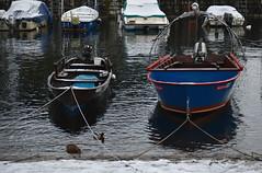 Il burchiello e la lancia a riposo (Irene Grassi (sun sand & sea)) Tags: italy lake water reflections lago harbor boat italia barche porto acqua riflessi lancia lagomaggiore cannobio barcheboats burchiello barcaaremi mazzardo