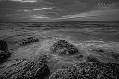 White & Black ( Hussain Frutan | www.hf-photos.net) Tags: sunset sea panorama sun black night speed sunrise landscape photography bahrain amazing nikon rocks exposure shot d sigma reflect 5200 kuwait 5000 nikkor 1020mm scape hdr manama settings bahrian hussain hf      fozool hsm cloued    muharaq d5000      cloueded ma7araq frutan wwwhfphotoscom