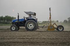 Farmer Krishna Chandra Yadav laser levels land for rice planting in Sirkohiya, Bardiya. (CIMMYT) Tags: nepal csisa cimmyt maize agriculture smallholder farmer mechanization asia