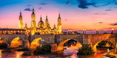 Baslica del Pilar | Zaragoza, Spain (NicoTrinkhaus) Tags: basilica del pilar castle disney bridge water river sunset sky lights cityscape citylights beautiful romantic zaragoza spain sunrise hdr hdrphotography fineart light colors architecture clouds