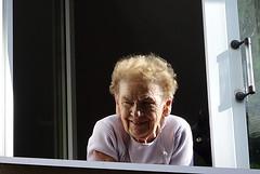 A cat and his owner (Aga Dzięcioł) Tags: cat woman window elderly elderlywoman oldwoman oldage