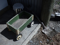My Battery's Gone (Steve Taylor (Photography)) Tags: trolly cart shovel spade battery cloth shed outhouse muted fun wooden wood newzealand nz southisland canterbury bankspeninsula shadow vehicle car
