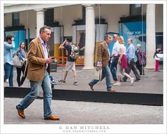 Walking Man, Mirrored Wall (G Dan Mitchell) Tags: mirror distorted man walking london england uk unitedkingdom people street photography travel sidewalk