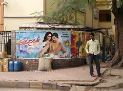 street corner stand-off (Dean Forbes) Tags: india man poster bangalore