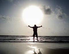 Icarus (kt.beyondperception) Tags: ocean blue sunset shadow sea sky people sun india motion beach water silhouette sunrise fun hope fly jump sand frolic friendship faith goa solo freeze lonely arabian icarus optimism leap birdman