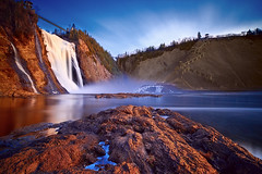 Montmorency Falls #3 [EXPLORE] (MagnusL3D) Tags: longexposure bridge blue trees winter white snow canada reflection ice water rock stone pinetree clouds stairs zeiss photoshop sunrise golden waterfall nikon rocks quebec stones lookout cliffs spray hills explore filter foam lee filters 2012 kanada cs6 explored captureone leefilters distagont2821 bigstopper leebigstopper topazinfocus d800e