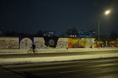 Bike : Berlin Wall (Jon | Running at Dawn) Tags: road street winter snow bike night germany cycling cyclist streetlamp freezing berlinwall eastsidegallery fujix100 viewofthewest