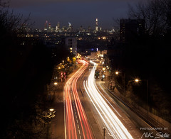 London Skyline from North London / London UK (Niels Photography) Tags: london skyline uk united kingdom cityscape urban citylife traffic trails long exposure night image photography lights stream light cars archway a1 hornsey lane bridge view north londen londres digital blending photoshop buildings shard citycenter tower 42 st pauls gherkin heron broadgate bus buses england gb great britain canon eos 500d rebel t1i 50mm vertorama nielskristianphotography