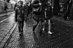 The little people (The City) (Daan L) Tags: christmas street xmas city people urban white holiday black holland monochrome digital shopping season mono noir candid 4 nederland strangers metropolis gr nl schwartz zwart wit weiss iv blanc ricoh stad 2012 kerstmis straat absorption 070 dutch thenetherlands thehague denhaag lahaye richohgrdigitaliv daanl