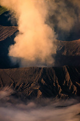 Smoke Coming From Mt Bromo (Mytruestory Photography) Tags: beautyinnature bromotenggersemerunationalpark colorimage danger day eastjavaprovince heattemperature highangleview idyllic indonesia landscape mtbromo nature nopeople outdoors photography remote smokephysicalstructure sunrisedawn tranquility vertical volcaniccrater volcaniclandscape volcano mytruestory mytruestoryphotography