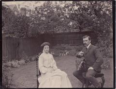 The First Quarrel (EastMarple1) Tags: edwardian beauty garden cigar man woman moustache fashion quarrel fence house trees vintage