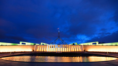 Blue hour at Parliament House (Pat Charles) Tags: canberra act australian capital territory australiancapitalterritory parliamenthouse government sunset evening dusk bluehour parliament senate representatives house lower upper reflection reflected flag nikon 1001nights 1001nightsmagiccity