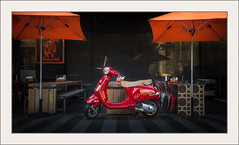A touch of Italy in the heart of Melbourne (Chas56) Tags: melbourne europe bike motorbike vespa red city colour campari scooter motorscooter orange umbrella cafe canon canon5dmkiii urban border photoborder