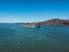 big boat, small boats (flrent) Tags: sanfrancisco california unitedstates boat containers dock port golden gate bridge