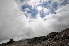 Sun and clouds above Arrow Glacier Camp - Kilimanjaro National Park - Tanzania (PascalBo) Tags: nikon d300 tanzania tanzanie africa afrique eastafrica afriquedelest kilimanjaro kilimandjaro kilimanjaronationalpark parcnationaldukilimandjaro arrowglacier lemosho hike hiking trek trekking outdoor outdoors volcanic rock stone landscape paysage tent bivouac camp campement clouds nuages sky ciel pascalboegli