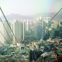 (*YIP*) Tags: city blue trees sky mountain tower 120 6x6 film skyline architecture skyscraper mediumformat square photography cityscape outdoor bare branches capital landmark seoul epson southkorea scenics namsan kiev60 communicationstower namsantower iso160 colorimage v500 nseoultower epsonv500 yipchoonhong